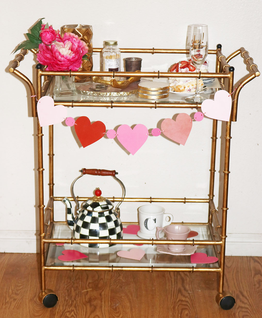 Candace Rose decorated her Valentine's Day bar cart with an agate cheeseboard, Mackenzie-Childs teak kettle, tea cups and a heart garland on Candie Anderson blog candieanderson.com blog