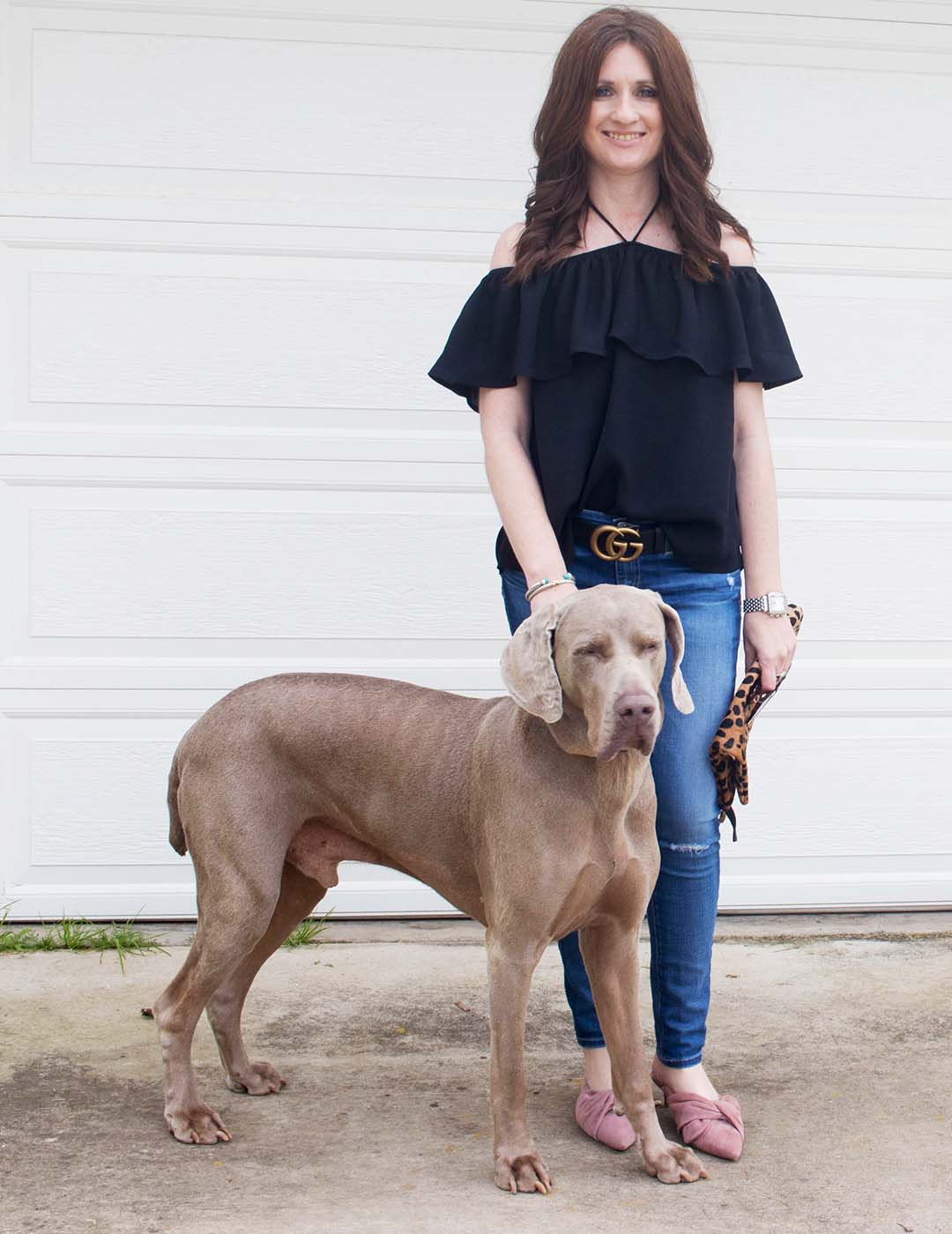 Style expert and blogger, Candie Anderson shares her BB Dakota Edmonds off the shoulder halter top in black, AG legging ankle jeans, Sam Edelman Laney mules in dusty rose pink. These items are on sale at Shopbop.