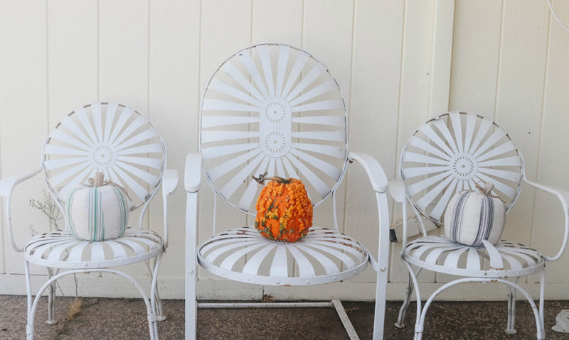 Lifestyle expert and blogger, Candie Anderson decorates her farmhouse fall front porch with Way to Celebrate Thanksgiving Multicolor Striped Fabric Pumpkins and a real heirloom pumpkin.