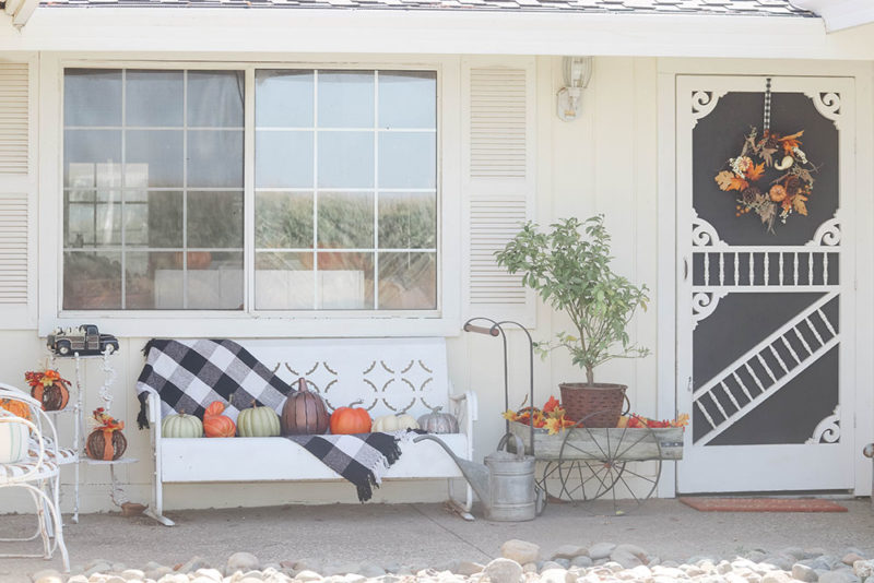 Lifestyle expert Candace Rose Anderson of the blog Candie Anderson shows how she decorated her fall inspired front porch with farmhouse inspired decor items including her gorgeous wreath, buffalo check blanket and pumpkins.